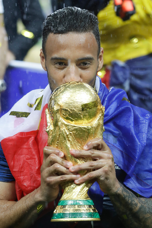 . France\'s Corentin Tolisso kisses the trophy at the end of the final match between France and Croatia at the 2018 soccer World Cup in the Luzhniki Stadium in Moscow, Russia, Sunday, July 15, 2018. (AP Photo/Matthias Schrader)