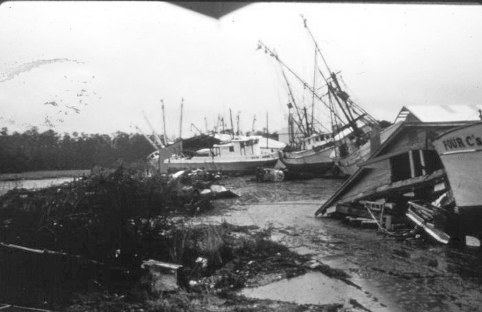 . Channel on left was location of fishing vessels before being deposited on land, McClellanville, South Carolina, Late September, 1989. National Hurricane Center. NOAA\'s National Weather Service (NWS) Collection