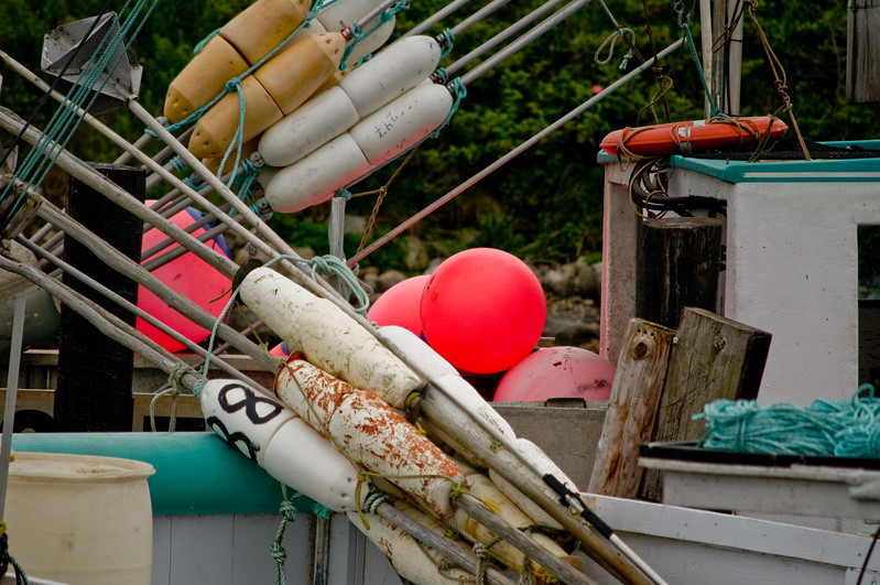 I'm guessing these markers and buoys are for the traps they have stacked up. Colorful though, aren't they?