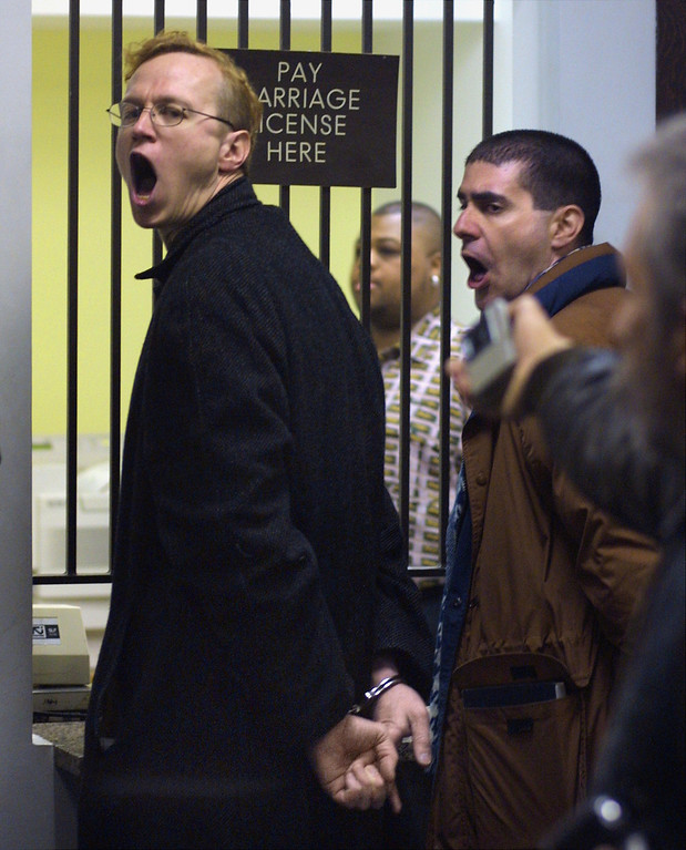 . Michael Maltenfort, left, and Andy Thayer yell as they are lead away by two police officers for trying to lock and chain one of two doors at the Cook County, Illinois Marriage License Bureau after unsuccessfully requesting a marriage license February 14, 2001 inside Chicago\'s City Hall. The two were part of a group of Gay rights protesters. The Chicago Anti-Bashing Network organized the protest, called Freedom To Marry Day, to renew attention to gay marriage as an important civil rights issue and to counter anti-gay groups claim that it poses a threat to society. (Photo by Tim Boyle/Newsmakers)