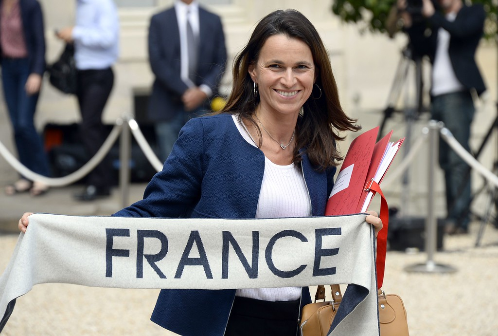 . French Culture minister Aurelie Filippetti shows a scarf to support the French national football team as she leaves the Elysee presidential palace in Paris, after the weekly cabinet meeting on June 11, 2014. The players arrived in Brazil last Monday, three days ahead of the FIFA World Cup 2014. AFP PHOTO/BERTRAND GUAY/AFP/Getty Images