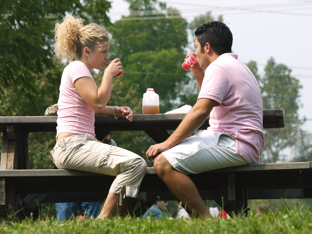 . Meghan Dehring, 18, drinks cider with her boyfriend Giovanni Bugli, 19, (both of Shelby Township) at Yates Cider Mill.  Photographed Sunday, September 4, 2004.