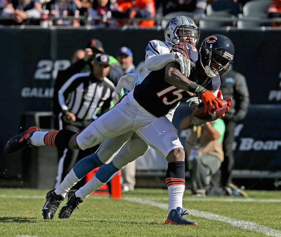 . Brandon Marshall #15 of the Chicago Bears catches a touchdown pass under pressure from Darius Slay #30 of the Detroit Lions at Soldier Field on November 10, 2013 in Chicago, Illinois. (Photo by Jonathan Daniel/Getty Images)