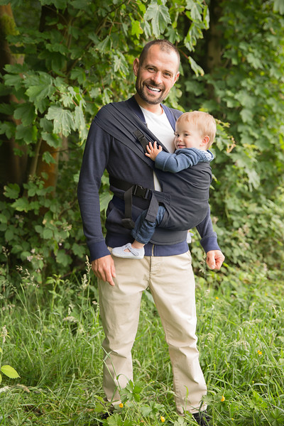 Izmi_Toddler_Carrier_Midnight_Blue_Side_Carry_Dad_smiling.jpg