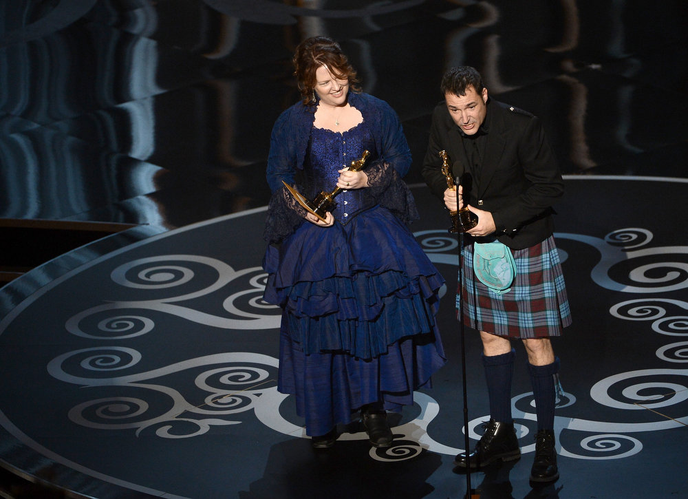 ". Co-directors Brenda Chapman and Mark Andrews accept the Best Animated Feature Film award for ""Brave\"" onstage during the Oscars held at the Dolby Theatre on February 24, 2013 in Hollywood, California.  (Photo by Kevin Winter/Getty Images)"