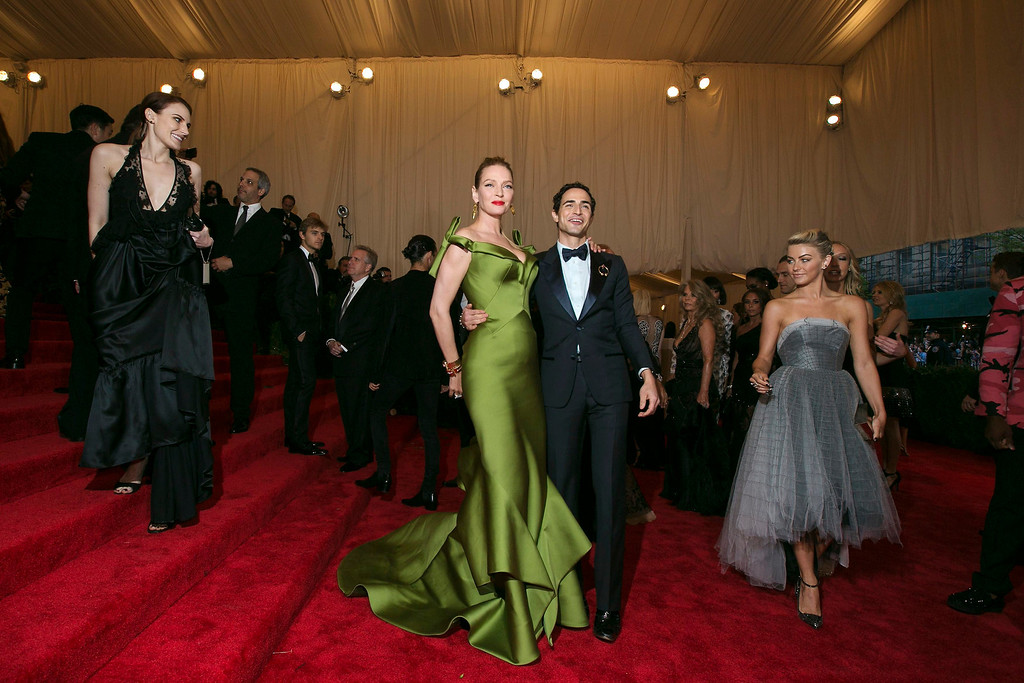 """. Actress Uma Thurman arrives with designer Zac Posen at the Metropolitan Museum of Art Costume Institute Benefit celebrating the opening of \""""PUNK: Chaos to Couture\"""" in New York, May 6, 2013. REUTERS/Lucas Jackson"""