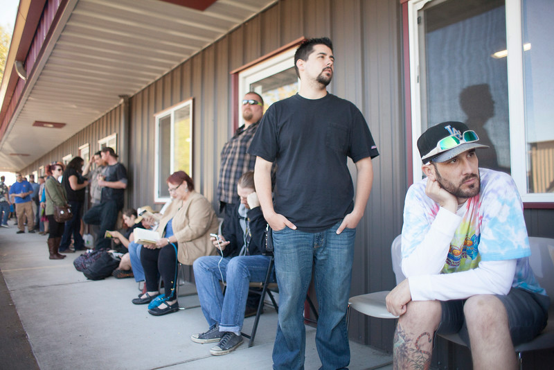 . Customers wait in line at Top Shelf Cannabis, a retail marijuana store, on July 8, 2014 in Bellingham, Washington. Top Shelf Cannabis was the first retail marijuana store to open today in Washington state, nearly a year and a half after the state\'s voters chose to legalize marijuana.  (Photo by David Ryder/Getty Images)