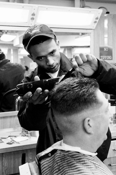 LPO MM GSM1 Ayres hair being cut in the barber shop by SH3 Tillet.