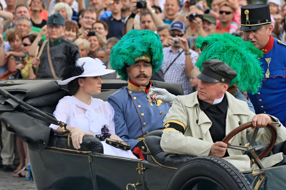 . People reconstruct a scene on June 28, 2014 in Brno, Czech Republic of Austrian Archduke Franz Ferdinand (C) and his wife Sophie, Duchess of Hohenberg (L) who were killed on June 28, 1914 in an old Daimler car in Sarajevo. Bosnia marked 100 years since the assassination of Ferdinand in Sarajevo that sparked World War I, but the divisive legacy of the gunman Gavrilo Princip meant Serbs were shunning the event. (RADEK MICA/AFP/Getty Images)