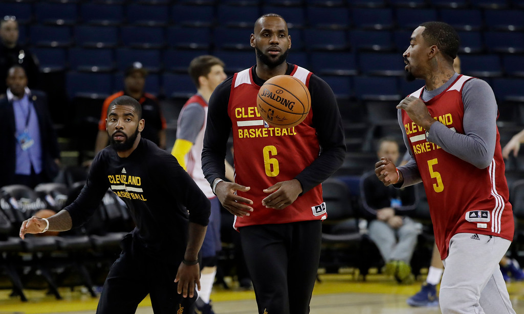 . From left, Cleveland Cavaliers\' Kyrie Irving, LeBron James and J.R. Smith work on drills during an NBA basketball practice, Wednesday, May 31, 2017, in Oakland, Calif. The Cavaliers face the Golden State Warriors in Game 1 of the NBA Finals on Thursday in Oakland. (AP Photo/Marcio Jose Sanchez)