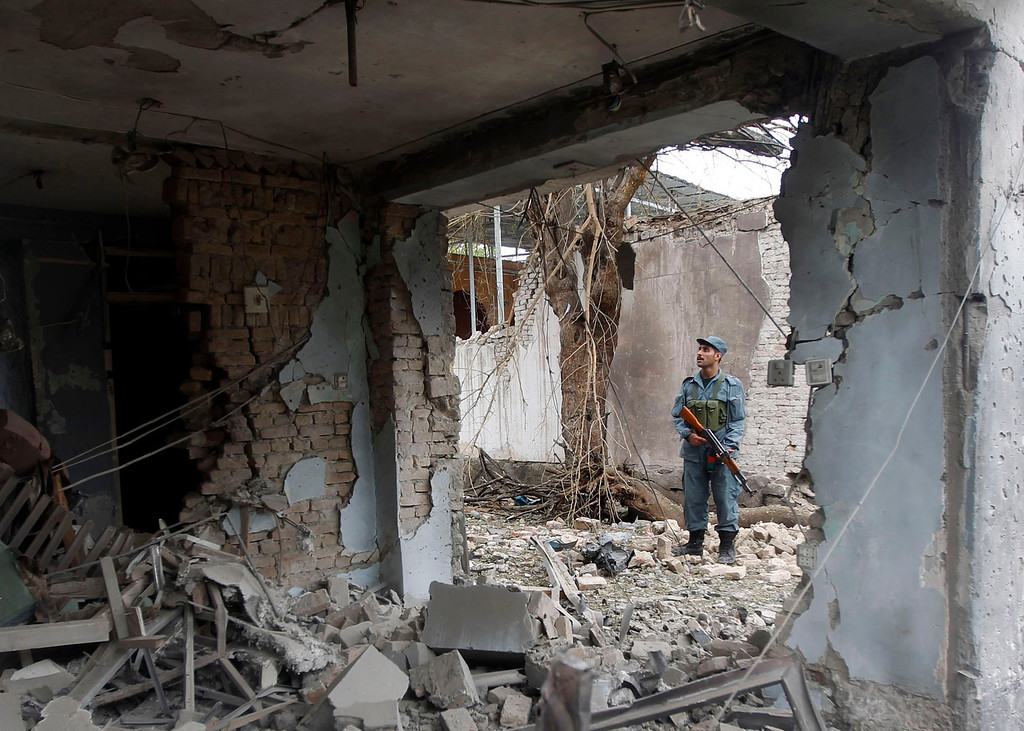 . An Afghan policeman stands at the site of a suicide attack at the Indian consulate in Jalalabad province August 3, 2013. A suicide bomber attacked the Indian consulate in the eastern Afghan capital of Jalalabad on Saturday, Indian officials and local police said, killing six people and wounding 22. REUTERS/Parwiz