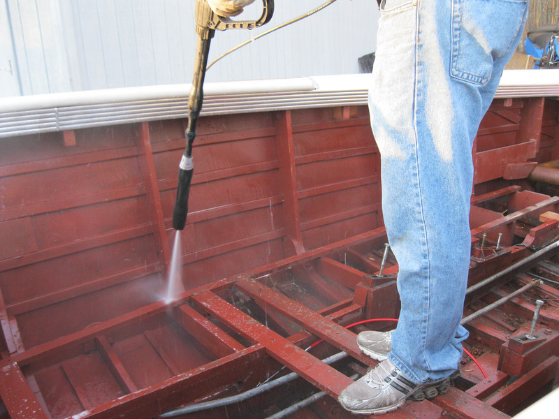 Power washing the bilge.