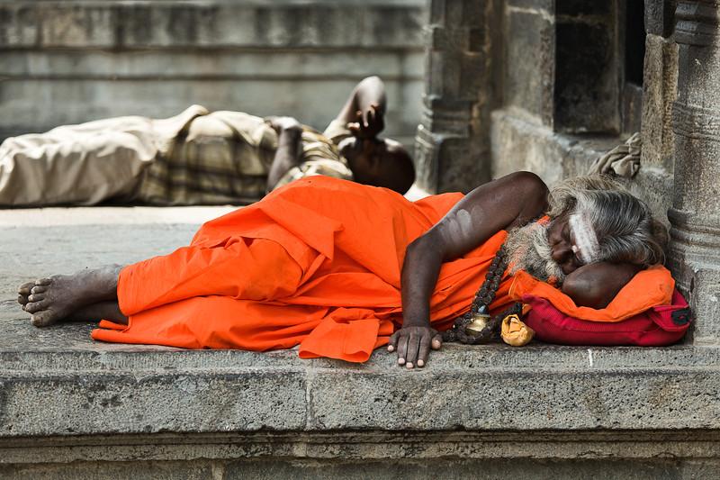 Sadhu sleeping in temple