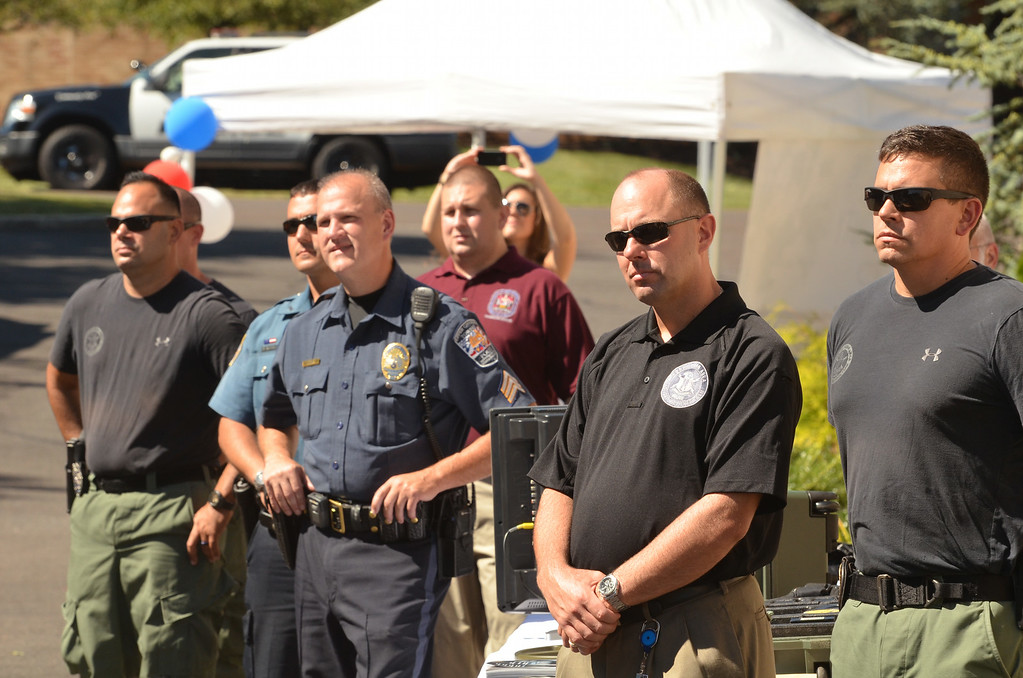 . Membes of the law enforcement community listen during a ceremony at WM Robots LLC in Colmar.   The company donated a robot to the Montgomery County District Attorney\'s office.     Thursday, August 28, 2014.  Photo by Geoff Patton