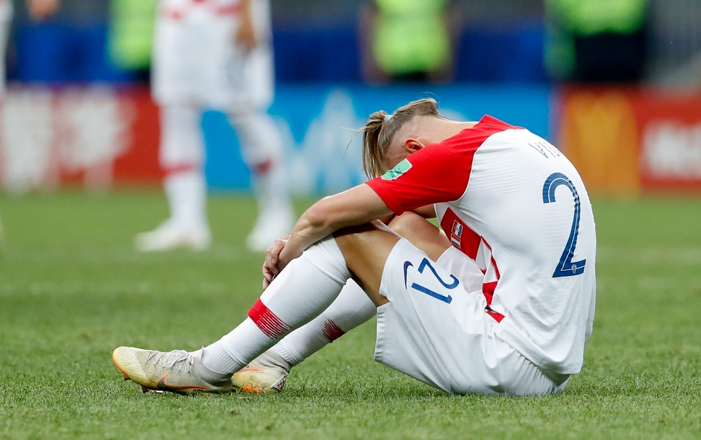 . Croatia\'s Domagoj Vida sits on the pitch at the end of the final match between France and Croatia at the 2018 soccer World Cup in the Luzhniki Stadium in Moscow, Russia, Sunday, July 15, 2018. France won 4-2. (AP Photo/Petr David Josek)