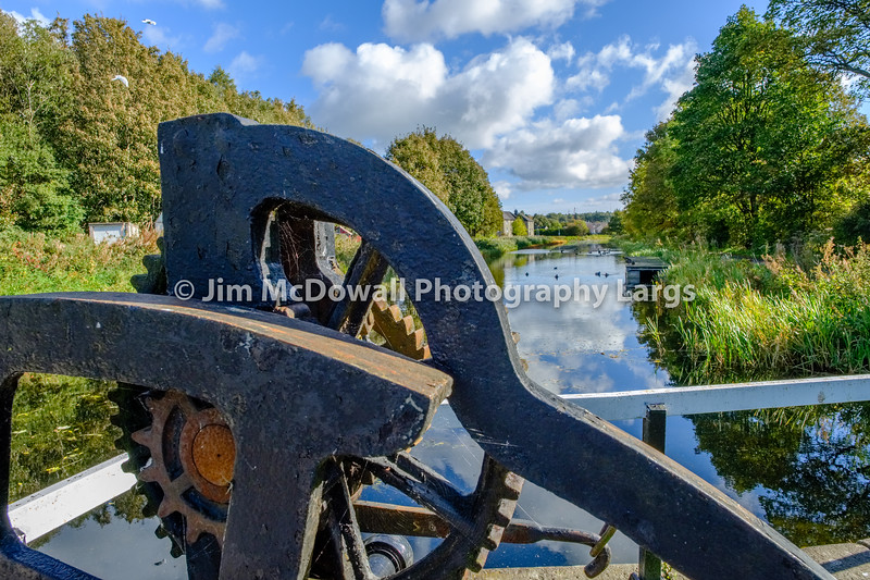 Looking over the Bridge Lock Mechanism down the old Fourth & Clyde canal in Autumn