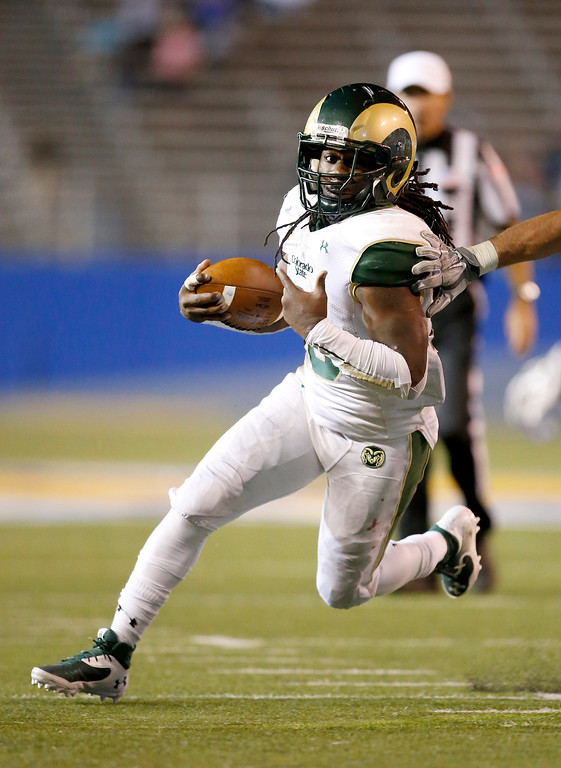 . Colorado State running back Dee Hart (10) runs with the ball for a first down against San Jose State during the second half of an NCAA college football game Saturday, Nov. 1, 2014, in San Jose, Calif. (AP Photo/Tony Avelar)