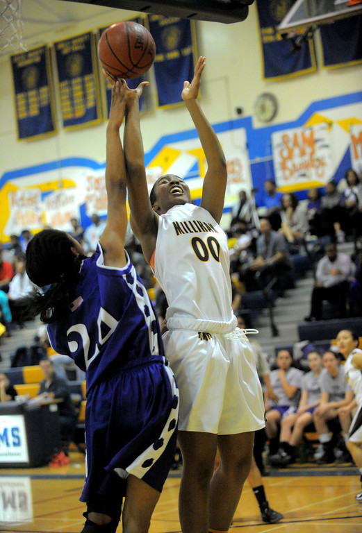 . 02-16-2012--(LANG Staff Photo by Sean Hiller)- Millikan vs. Rancho Cucamonga in Saturday night\'s  first-round CIF girls basketball game at Millikan High School in Long Beach. Millikan\'s Dionna Henley (00) battles Rancho\'s Alex Lindsey (24).
