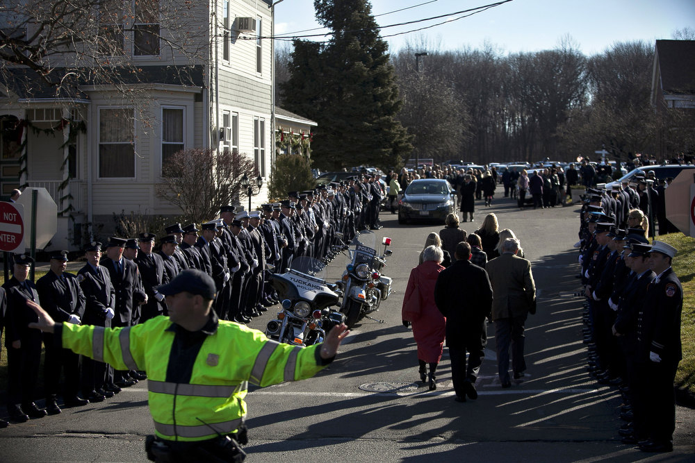 Description of . Mourners enter St. Rose of Lima Church for the funeral of Charlotte Bacon, 6, December 19, 2012 in Newtown, Connecticut. Six victims of the Newtown school shooting are being honored at funerals and visitations across the state today for the victims of Sandy Hook Elementary School. (Photo by Allison Joyce/Getty Images)