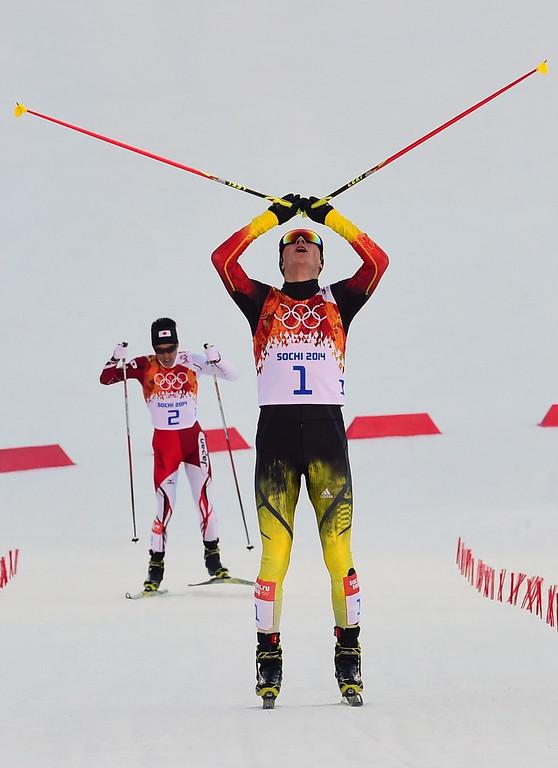 . Gold medalist Germany\'s Eric Frenzel celebrates as he cross the line followed by silver medalist Japan\'s Akito Watabe (2) in the Nordic Combined Individual NH / 10 km Cross-Country at the RusSki Gorki Jumping Center during the Sochi Winter Olympics on February 12, 2014, in Rosa Khutor near Sochi.  AFP PHOTO / JOHN MACDOUGALL/AFP/Getty Images