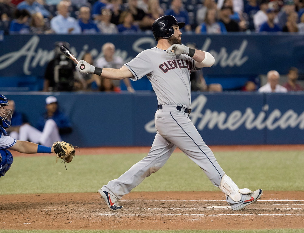. Cleveland Indians\' Jason Kipnis watches a three-run home run against the Toronto Blue Jays during the ninth inning of a baseball game Thursday, Sept. 6, 2018, in Toronto. (Fred Thornhill/The Canadian Press via AP)