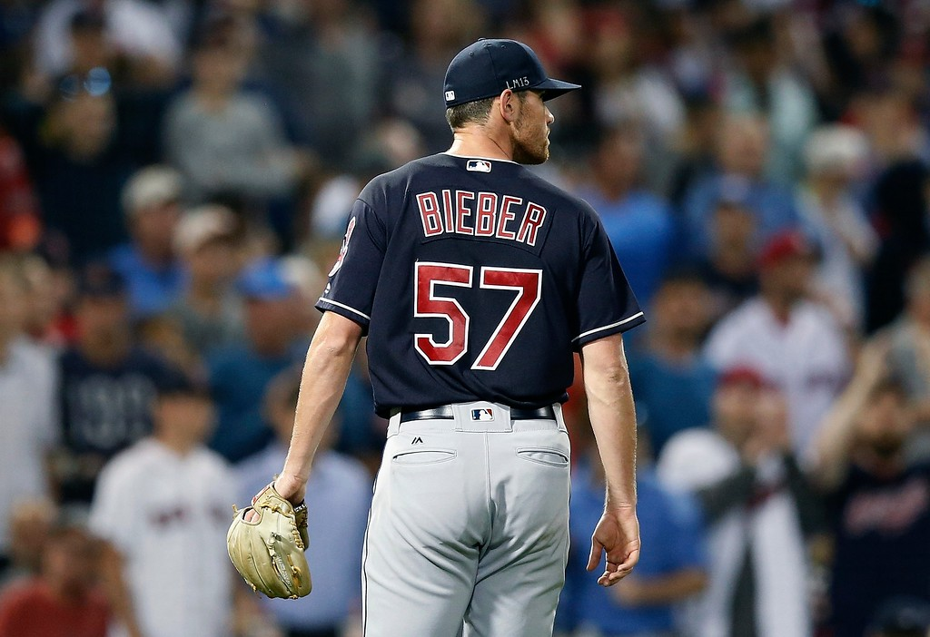 . Cleveland Indians\' Shane Bieber walks to the dugout after being relieved during the seventh inning of a baseball game against the Boston Red Sox in Boston, Tuesday, Aug. 21, 2018. (AP Photo/Michael Dwyer)