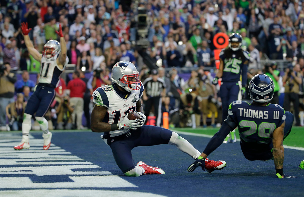 . New England Patriots wide receiver Brandon LaFell (19) scores a touchdown during the first half of NFL Super Bowl XLIX football game against the Seattle Seahawks Sunday, Feb. 1, 2015, in Glendale, Ariz. (AP Photo/Matt Slocum)