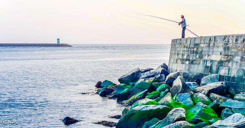 Fishing on rocks.jpg