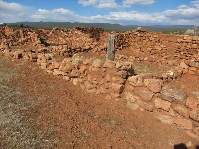 Pueblo wall construction of adobe and stone.