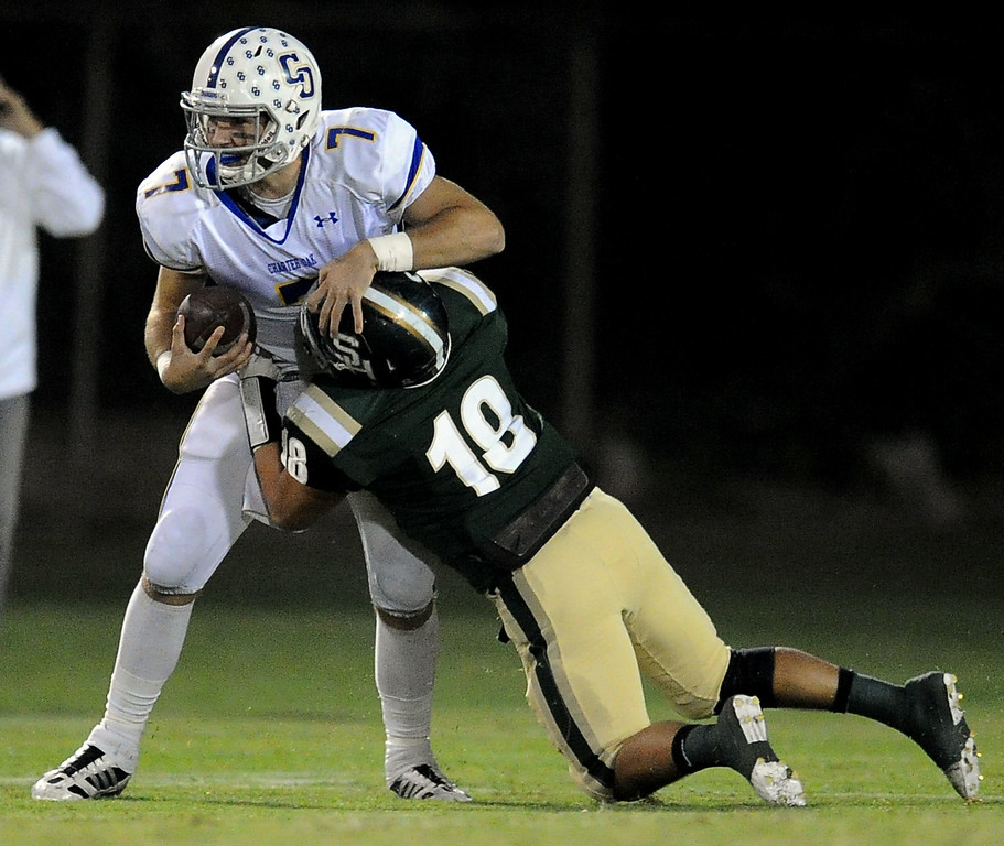 . Charter Oak quarterback Kory Brown (7) scrambles as South Hills\' Matthew Chavez (18) tackles in the first half of a prep football game at Covina DIstrict Field in Covina, Calif., on Thursday, Oct. 24, 2013. 