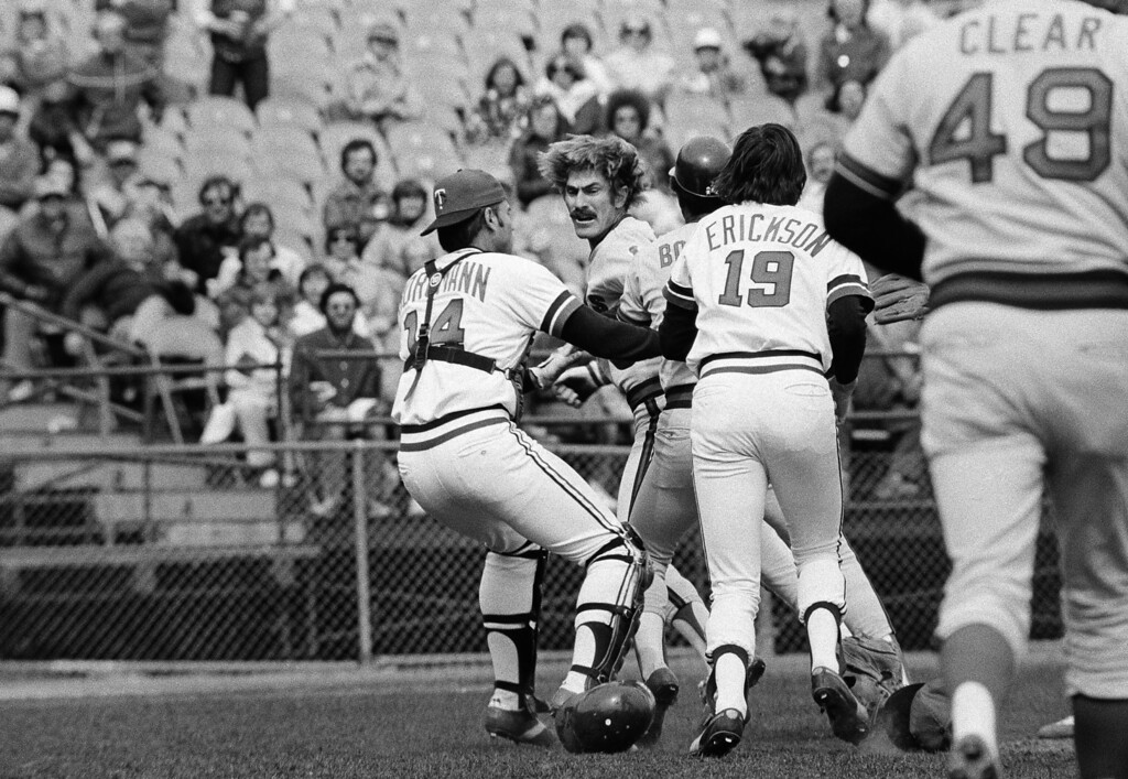 . California Angels Bobby Grich gives a menacing look toward Minnesota Twins\' pitcher Roger Erickson as Twins Glen Borgman, left, tries to keep them apart after Grich charged Erickson on the mound, April 22, 1978 in Bloomington over a pitch he didn\'t like. Both benches cleared and Grich was kicked out of the game. (AP Photo/Jim Mone)
