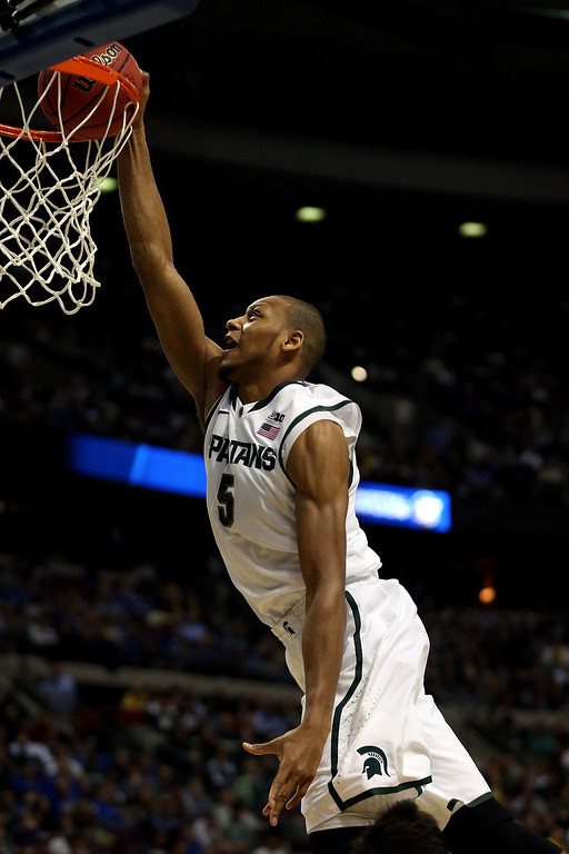 . Adreian Payne #5 of the Michigan State Spartans attempts a dunk  in the second half against the Valparaiso Crusaders during the second round of the 2013 NCAA Men\'s Basketball Tournament at at The Palace of Auburn Hills on March 21, 2013 in Auburn Hills, Michigan.  (Photo by Jonathan Daniel/Getty Images)