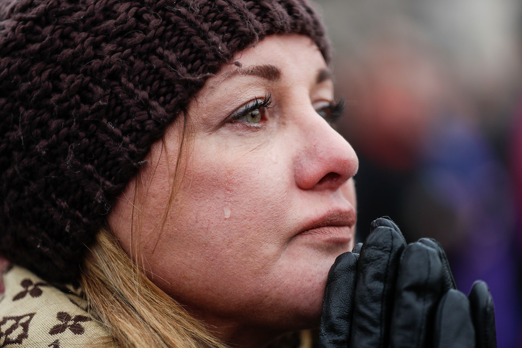 . Cheryl Edmondson cries as President-elect Donald Trump appears for his inauguration, Friday, Jan. 20, 2017, in Washington. (AP Photo/John Minchillo)