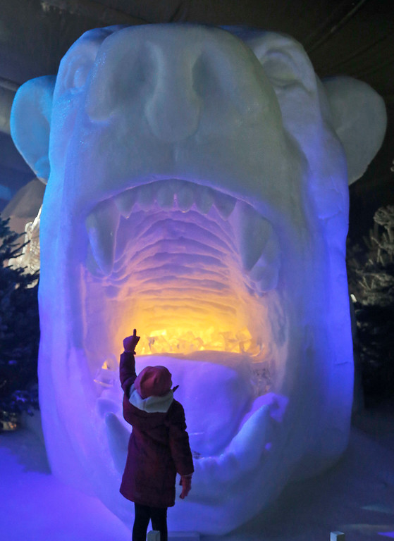 . Scarlett 4-years-old points to the teeth of a polar bear head ice sculpture at the launch of Hyde Park Winter Wonderland\'s Magical Ice Kingdom in London, Thursday, Nov. 17, 2016. This years Winter Wonderland starts on November 18,2016 and lasts until January 2, 2017. (AP Photo/Frank Augstein)