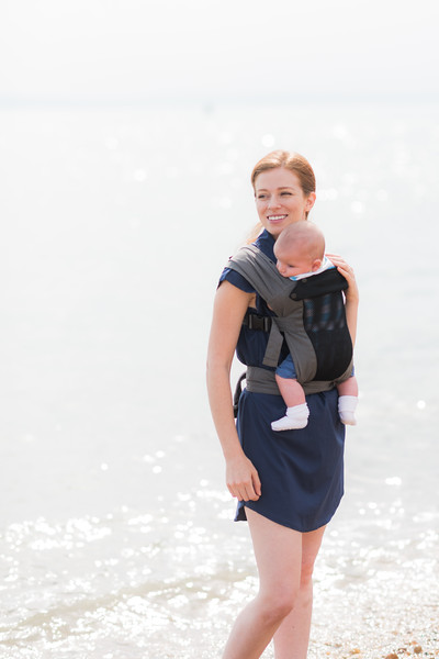 Izmi_Baby_Carrier_Breeze_Mid_Grey_Lifestyle_Front_Carry_Mum_On_Beach.jpg