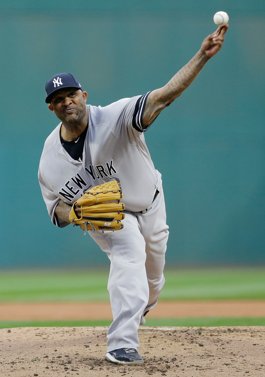 . New York Yankees starting pitcher CC Sabathia delivers in the first inning of Game 2 of baseball\'s American League Division Series against the Cleveland Indians, Friday, Oct. 6, 2017, in Cleveland. (AP Photo/Tony Dejak)