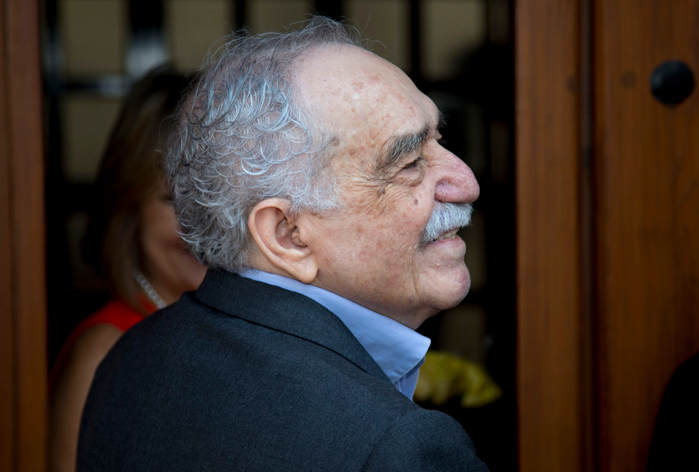 """. In this March 6, 2014, file photo, Colombian Nobel Literature laureate Gabriel Garcia Marquez greets fans and reporters outside his home on his birthday in Mexico City. Garcia Marquez, known as \""""Gabo\"""" in Latin America, turned 87.  Marquez has been hospitalized, Thursday April 3, 2014, at a local hospital in Mexico City. (AP Photo/Eduardo Verdugo, File)"""