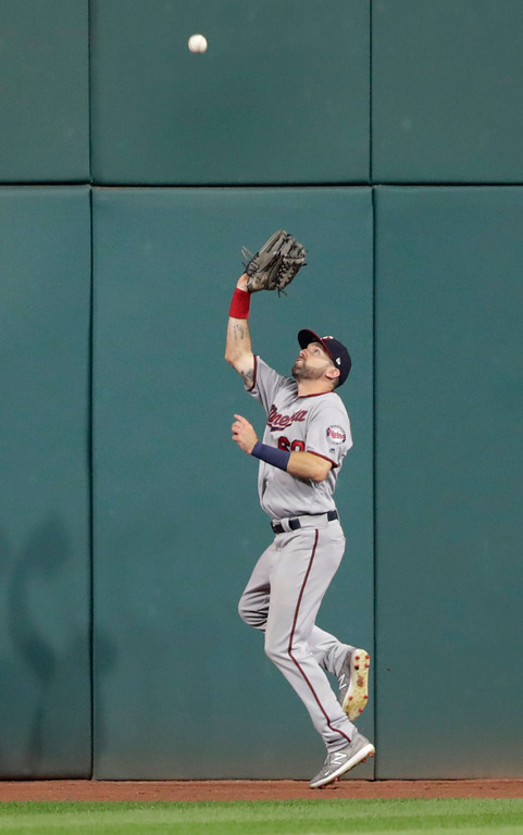 . Minnesota Twins\' Jake Cave catches a ball hit by Cleveland Indians\' Rajai Davis in the eighth inning of a baseball game, Monday, Aug. 6, 2018, in Cleveland. Davis was out on the play. (AP Photo/Tony Dejak)