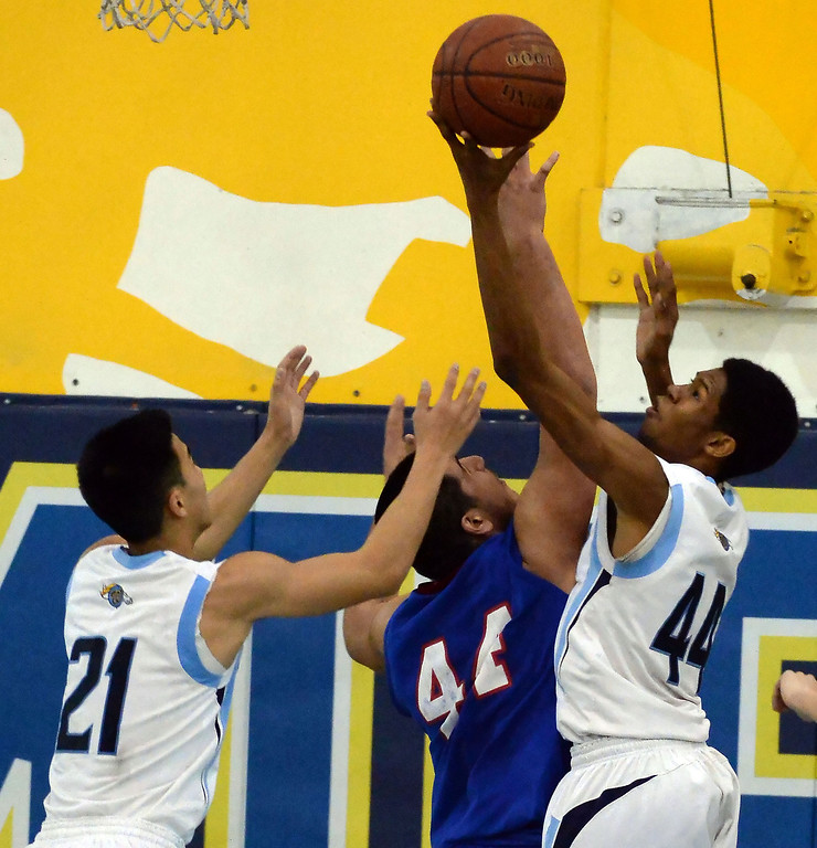 . Walnut\'s Richard Rycraw (C) (44) drives top the basket over Los Altos\' Jayson Jones (44) as Jeff Huang (21) looks on in the first half of a prep basketball game at Walnut High School in Walnut, Calif., on Wednesday, Jan. 22, 2014. (Keith Birmingham Pasadena Star-News)