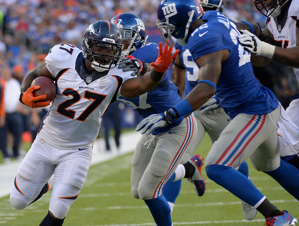 . September 15: running back Knowshon Moreno (27) of the Denver Broncos bullies his way into the endzone to make the score 6-3 in the second quarter vs the New York Giants at METLIFE Stadium. September 15, 2013 East Rutherford, NJ. (Photo By Joe Amon/The Denver Post)