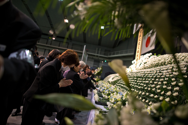 . Japanese people pay their respect during a memorial ceremony to commemorate the victims of the 2011 earthquake and subsequent tsunami on March 11, 2013 in Kesennuma, Japan. Japan is commemorating the second anniversary of the 2011 Magnitude 9.0 earthquake and subsequent tsunami that claimed more than 18,000 lives.  (Photo by Athit Perawongmetha/Getty Images)