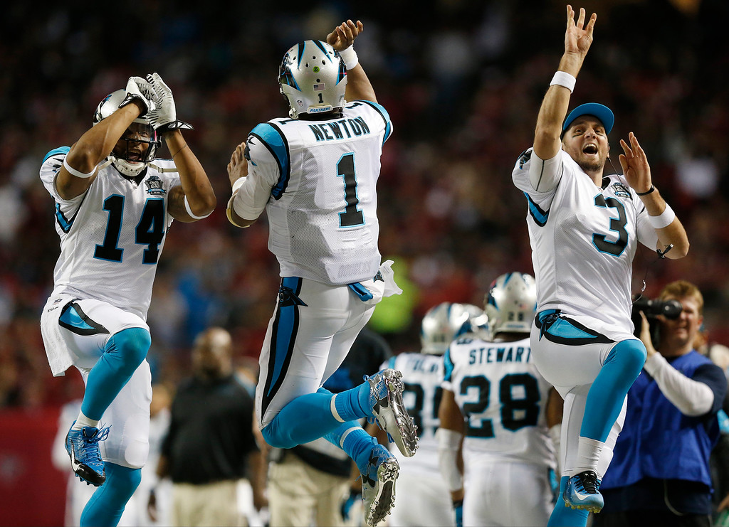 . Carolina Panthers quarterback Cam Newton (1) celebrates his touchdown with Joe Webb (14) and Derek Anderson (3) during the first half of an NFL football game against the Atlanta Falcons, Sunday, Dec. 28, 2014, in Atlanta. (AP Photo/Brynn Anderson)