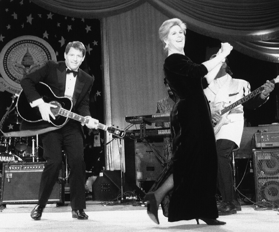 . Vice President Al Gore plays the guitar as his wife Tipper dances during their visit to the Tennessee Inaugural Ball in Washington, Jan. 21, 1993. (AP Photo/Barry Thumma)