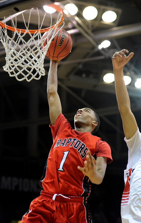 . BOULDER, CO. - MARCH 16: Raptors senior foward Rayjon Craig (1) jammed the ball through the hoop in the second half. The Eaglecrest High School boy\'s basketball beat Denver East 63-44 in the 5A championship game Saturday, March 16, 2013 at the Coors Events Center in Boulder.  (Photo By Karl Gehring/The Denver Post)