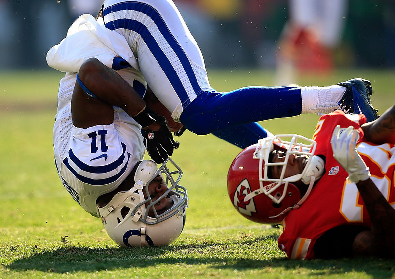 . Wide receiver Donnie Avery #11 of the Indianapolis Colts rolls over while trying to catch a pass as cornerback Brandon Flowers #24 of the Kansas City Chiefs defends during the game at Arrowhead Stadium on December 23, 2012 in Kansas City, Missouri.  (Photo by Jamie Squire/Getty Images)