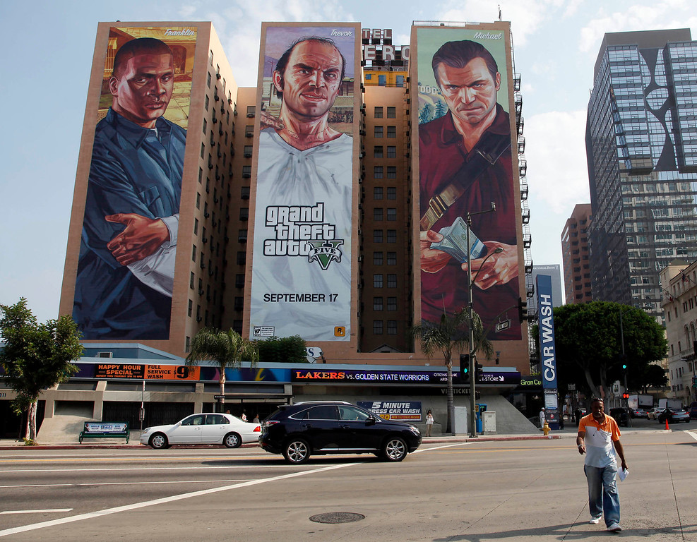 ". This Tuesday, Sept. 10, 2013 photo shows the ""Grand Theft Auto V \"" billboard at Figueroa Hotel in Los Angeles. ( AP Photo/Nick Ut)"