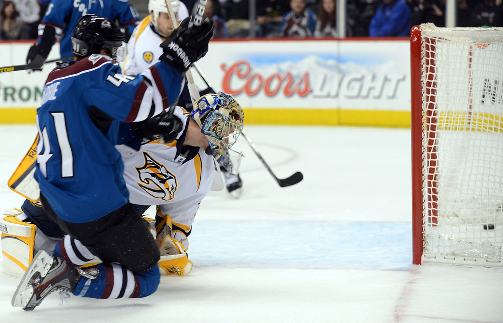 . DENVER, CO. - MARCH 30: Tyson Barrie of Colorado Avalanche (#41), left, scored the winning goal of the game from Pekka Rinne, goalie of Nashville Predators, (#35) in the over time at Pepsi Center. Denver, Colorado. March 30, 2013.  (Photo By Hyoung Chang/The Denver Post)