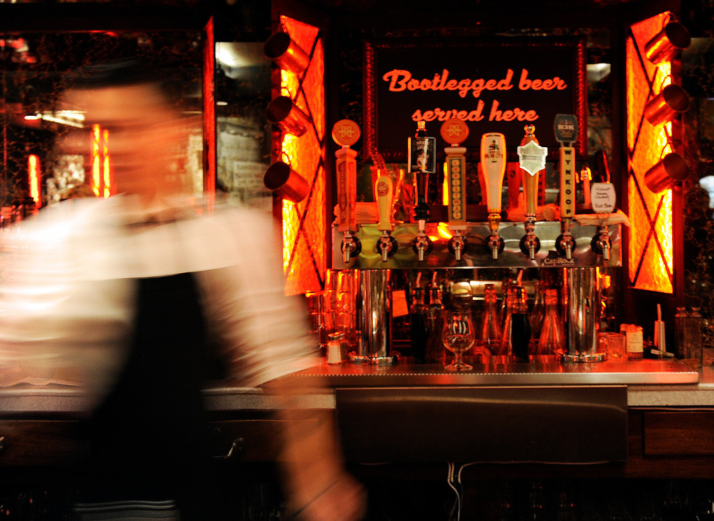 . Bar tender Anthony Giovanni, blurs past the taps of beer at  the newly remodeled Gaetano\'s in NW Denver at Tejon and W. 38th Ave on Tuesday, December 4, 2012.     Cyrus McCrimmon, The Denver Post