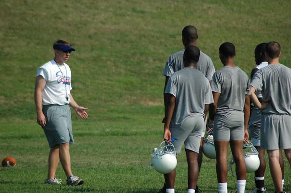 Football Players Begin Practice