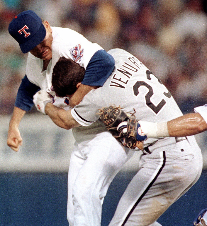 . FILE - In this Aug. 4, 1993, file photo, Texas Rangers pitcher Nolan Ryan, left, hits Chicago White Sox\'s Robin Ventura after Ventura charged the mound in Arlington, Texas. When Ventura makes his managerial debut for the White Sox on Friday, April 6, 2012, in a season opener at Texas, Ryan will be sitting in the front row of the Rangers\' new-look ballpark. (AP Photo/Linda Kaye, File)